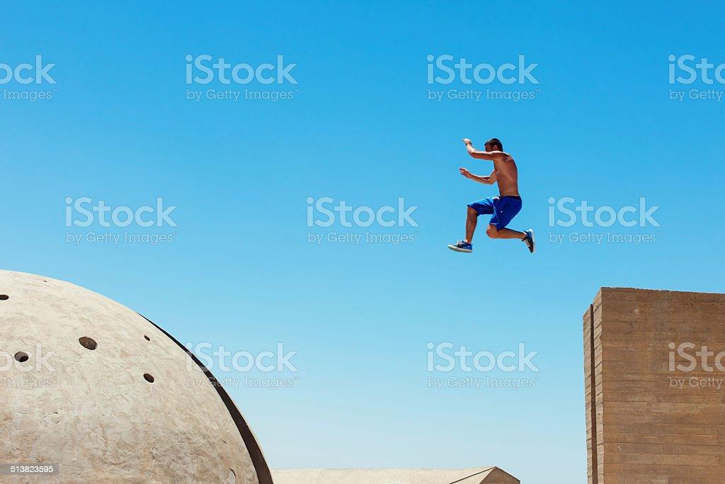 risky man jumping stock photo