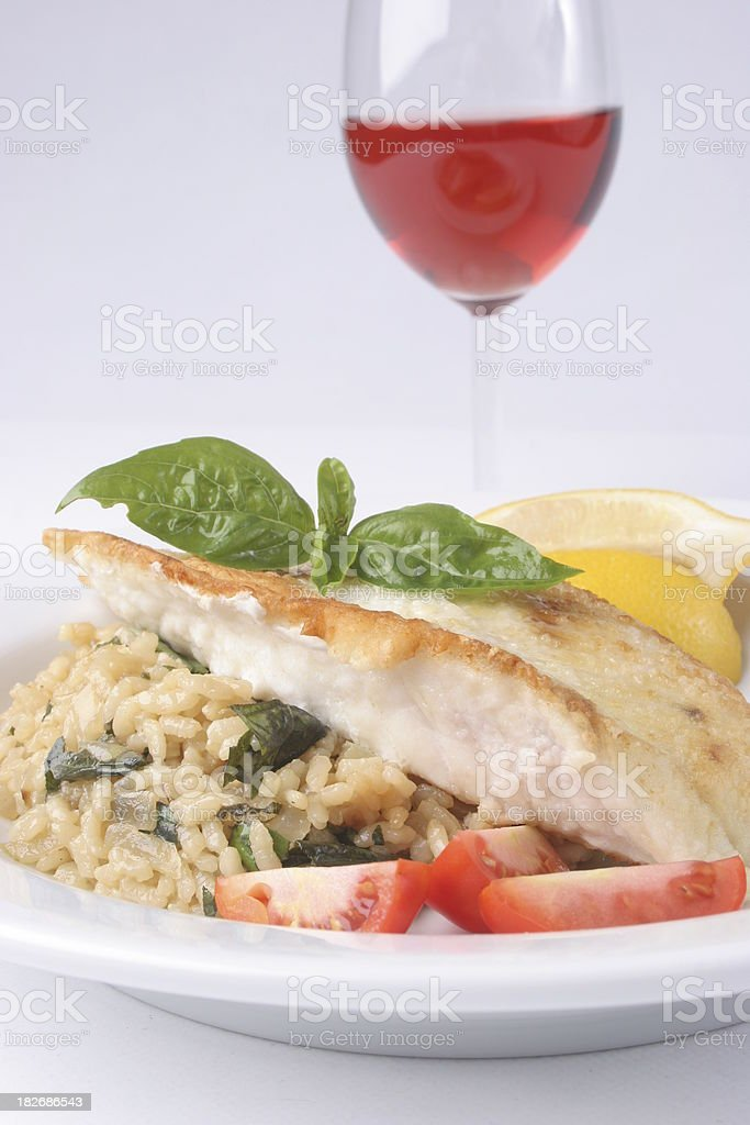 Risotto dinner with Snapper fillets royalty-free stock photo