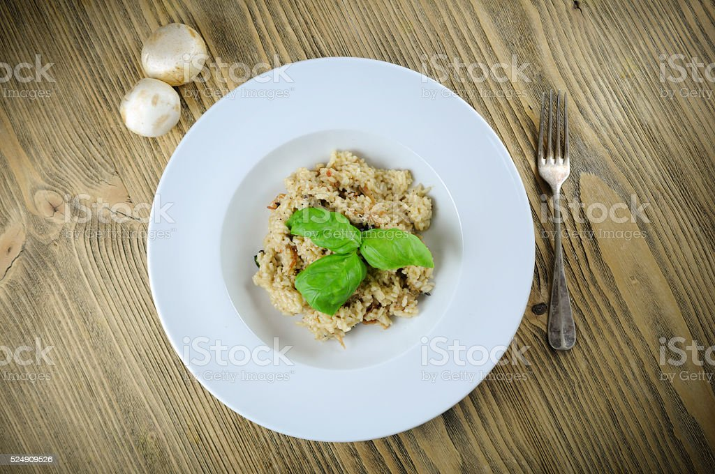 Risotto whit mushrooms and basil stock photo