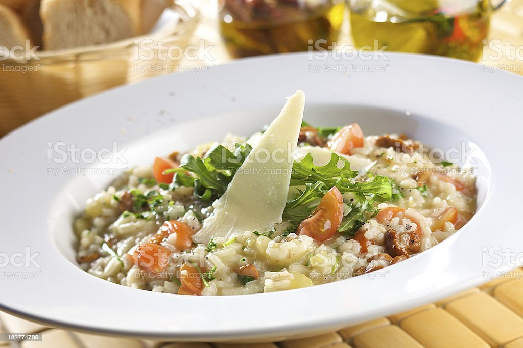 Risotto with chicken and cherry tomatoes royalty-free stock photo
