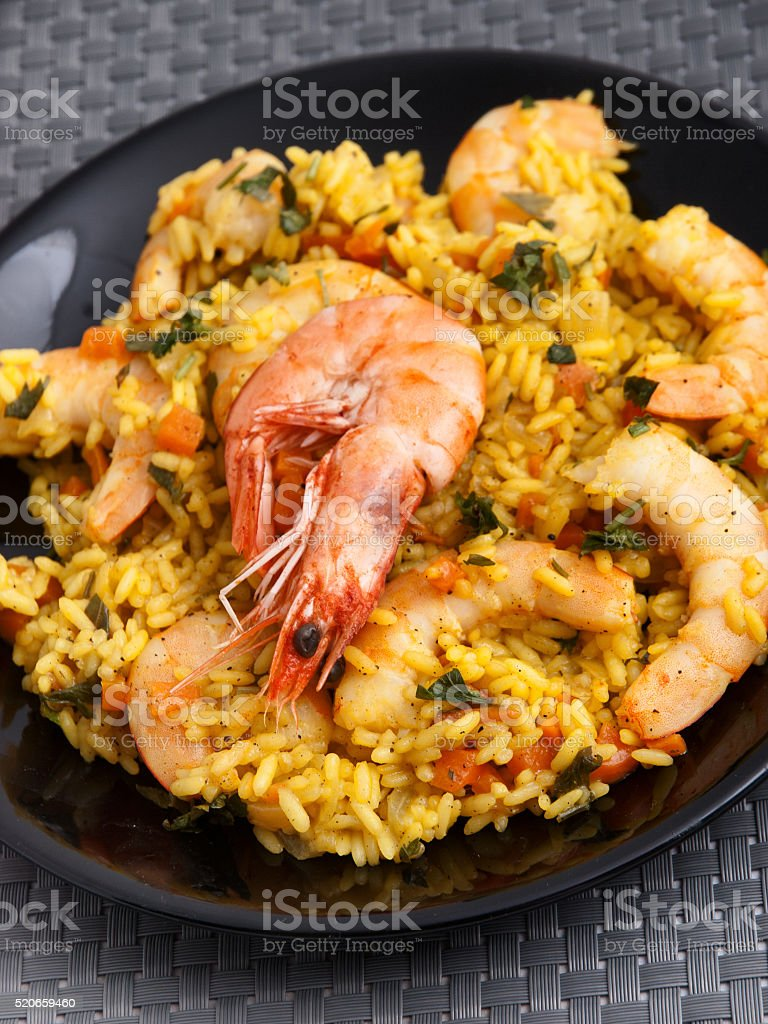 Risotto with curry and shrimps stock photo
