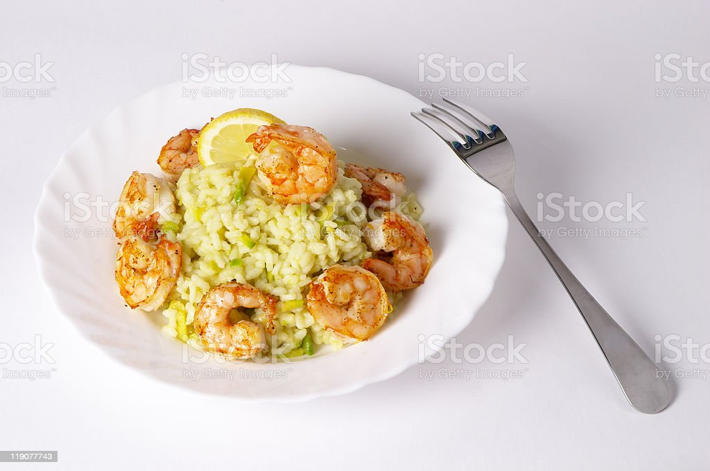 Risotto with fried prawns and avocado royalty-free stock photo