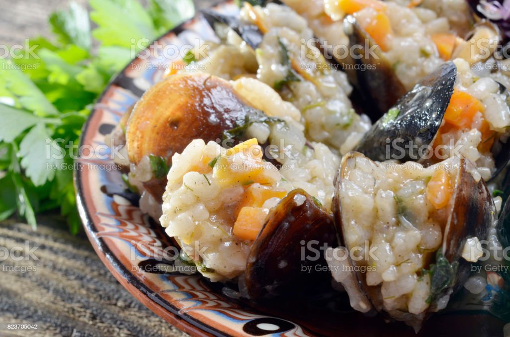 Risotto with mussels  in the plate stock photo