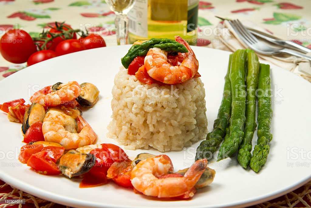 risotto with shrimp, mussels and asparagus royalty-free stock photo