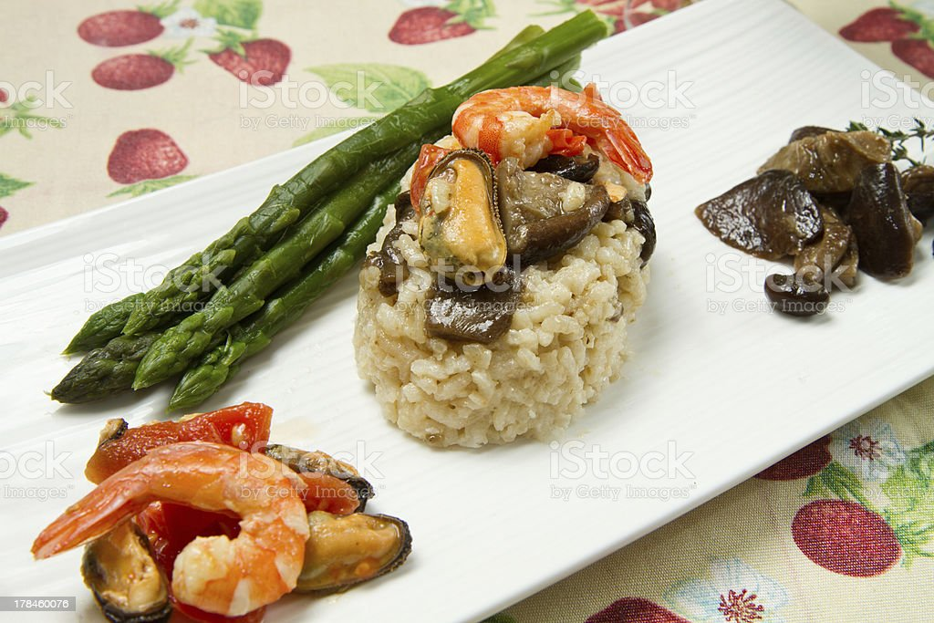 risotto with shrimp, mussels, asparagus and mushrooms royalty-free stock photo