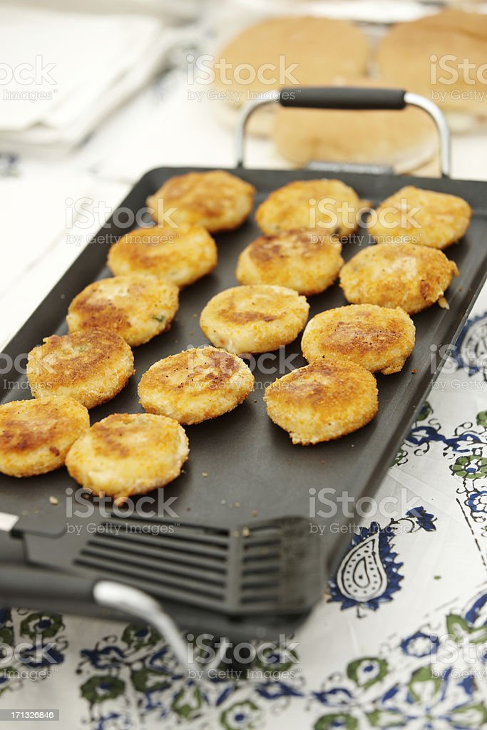 Rissoles cooking on a hotplate stock photo