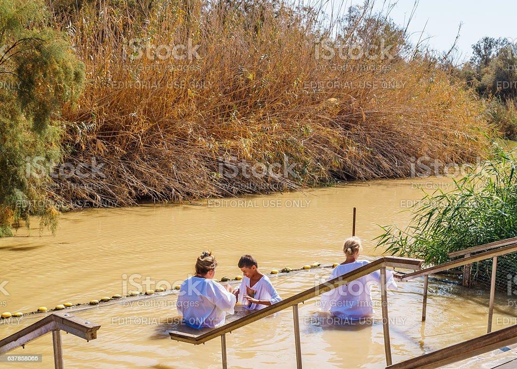Ritual bath in the Jordan river. Pilgrimage to  Holy Land stock photo