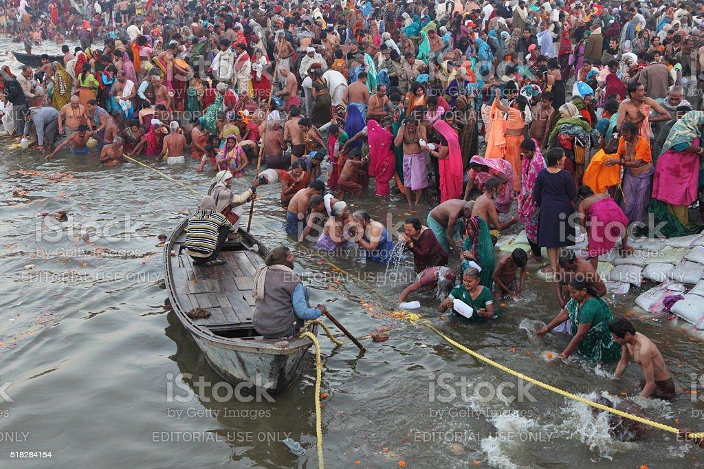 Ritual bathing during festival Maha Kumbh Mela at Ganges River stock photo