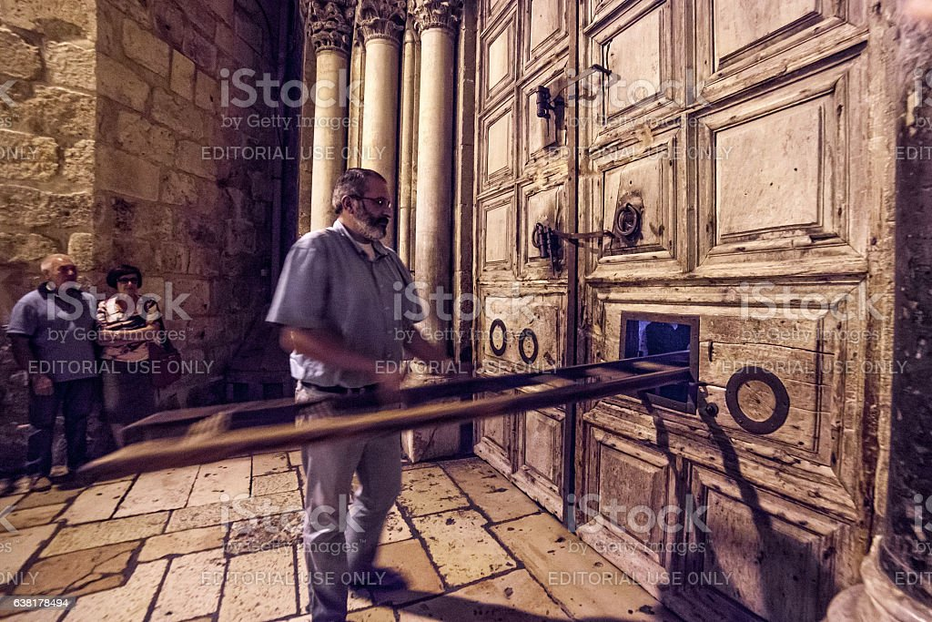 Ritual of closing doors of the Church of Holy Sepulchre stock photo