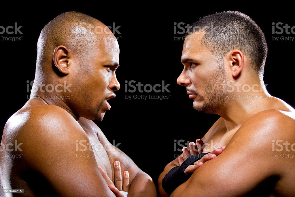 Rival Black and Latino Male Boxers or MMA Fighters stock photo