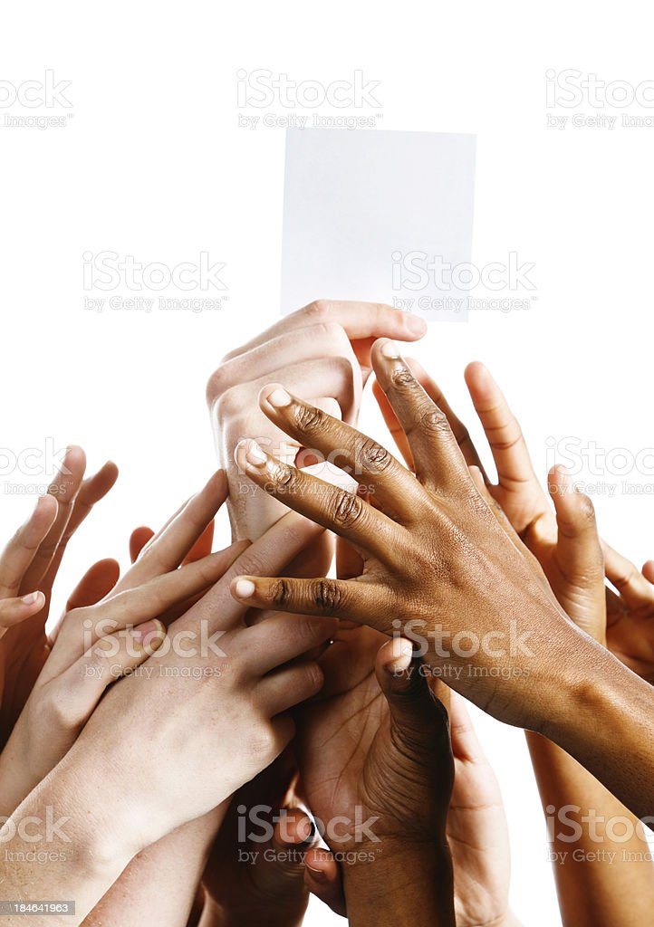 Rivalry as many hands reach up for blank card royalty-free stock photo