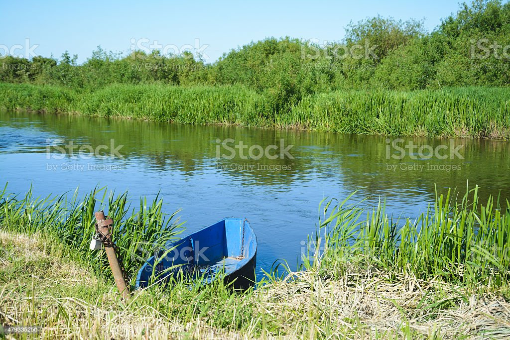 River and Blue Boat stock photo