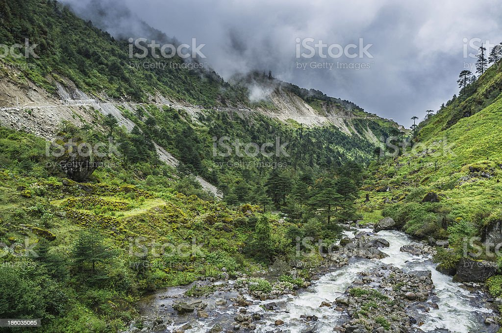 River and main highway to Tawang, Arunachal Pradesh, India. stock photo