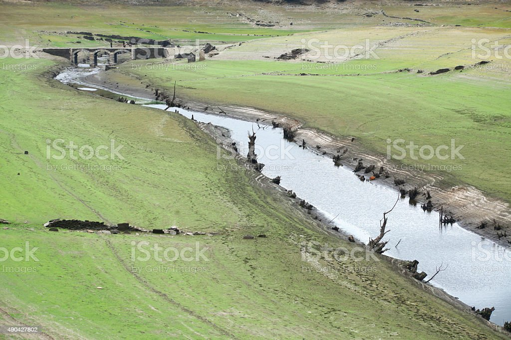 River and meadow landscape, bridges in the background. stock photo