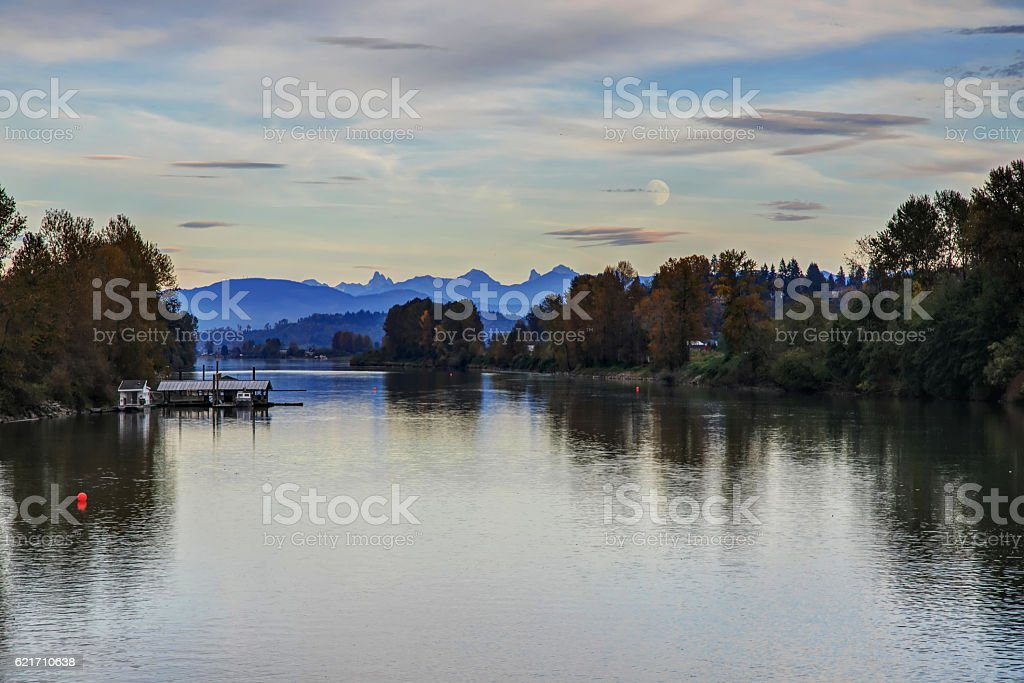 river and riverside in autumn at sunset time stock photo