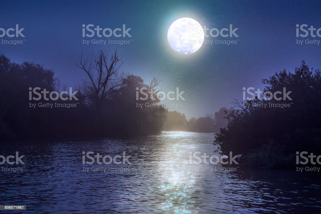 River at night with a full moon stock photo
