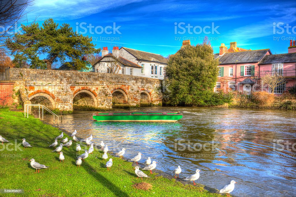 River Avon Christchurch Dorset England UK bridge and boat HDR stock photo