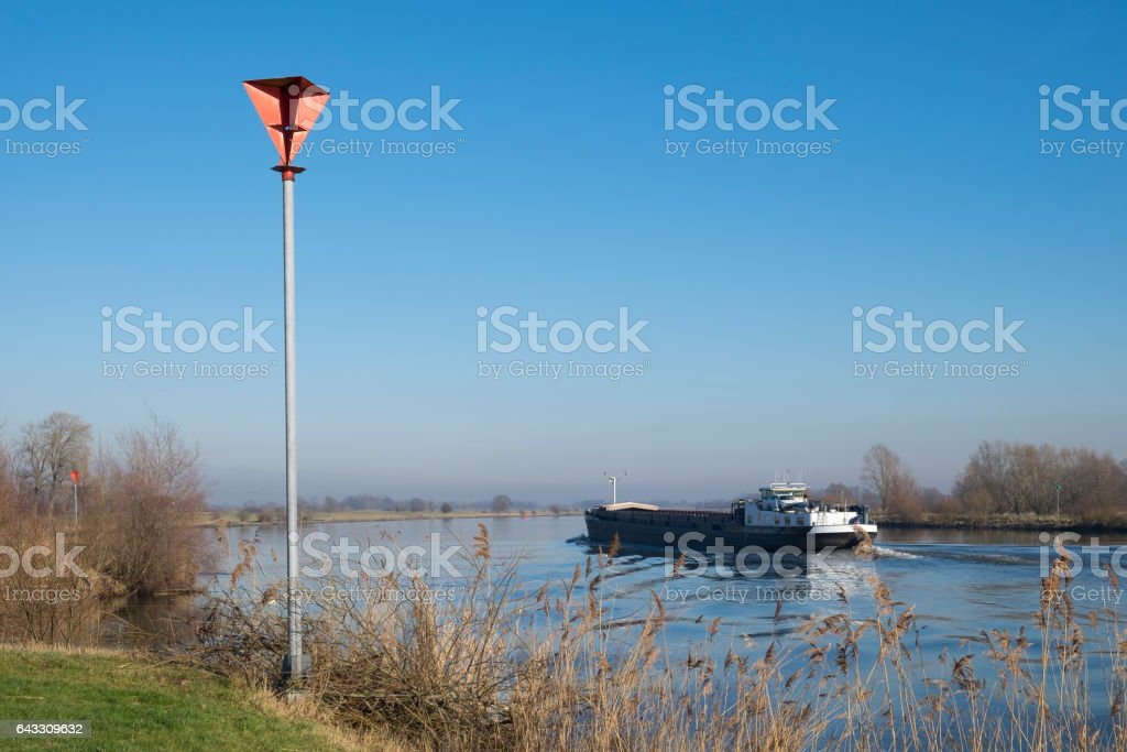 River barge sailing up the river IJssel in The Netherlands stock photo
