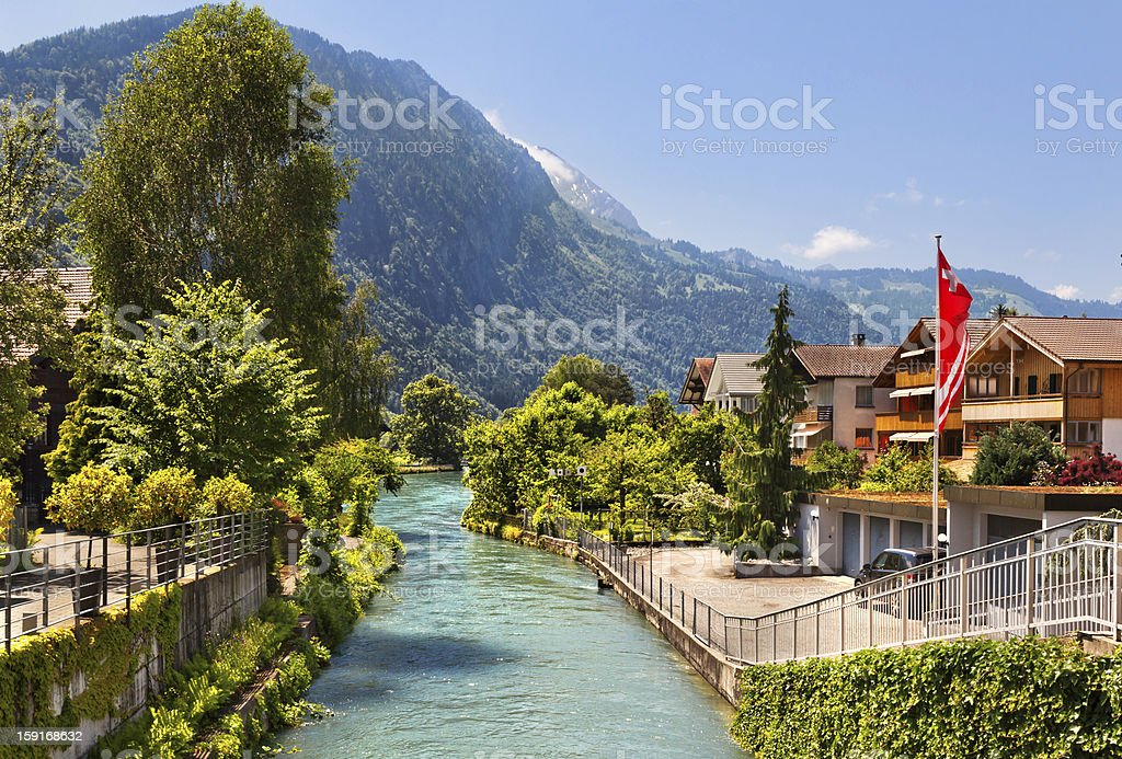 River between houses and trees in Interlaken, Switzerland stock photo
