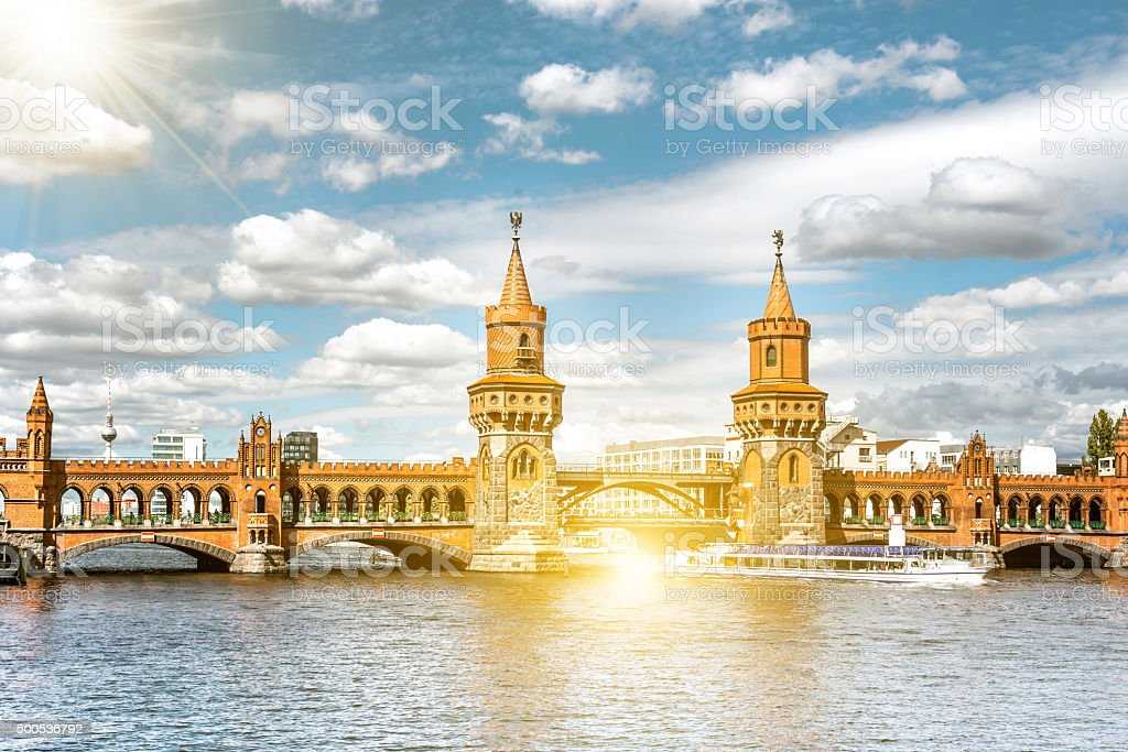 river boat passing the historic Berlin station Oberbaumbrücke stock photo