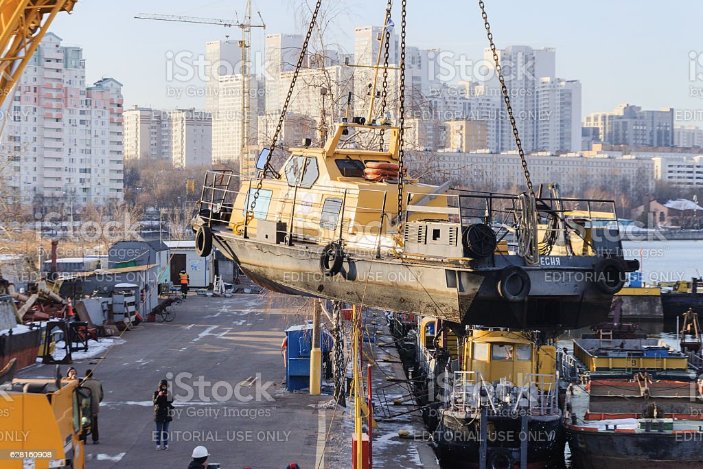 River boat transported by crane. stock photo