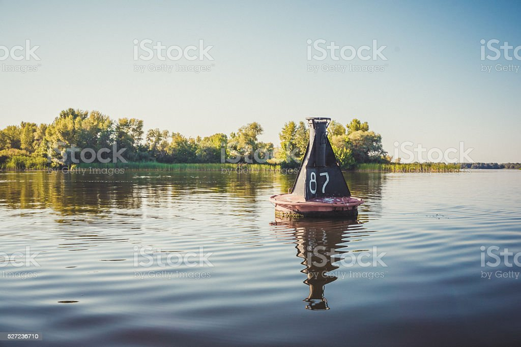 River buoy amid the calm water of the river stock photo