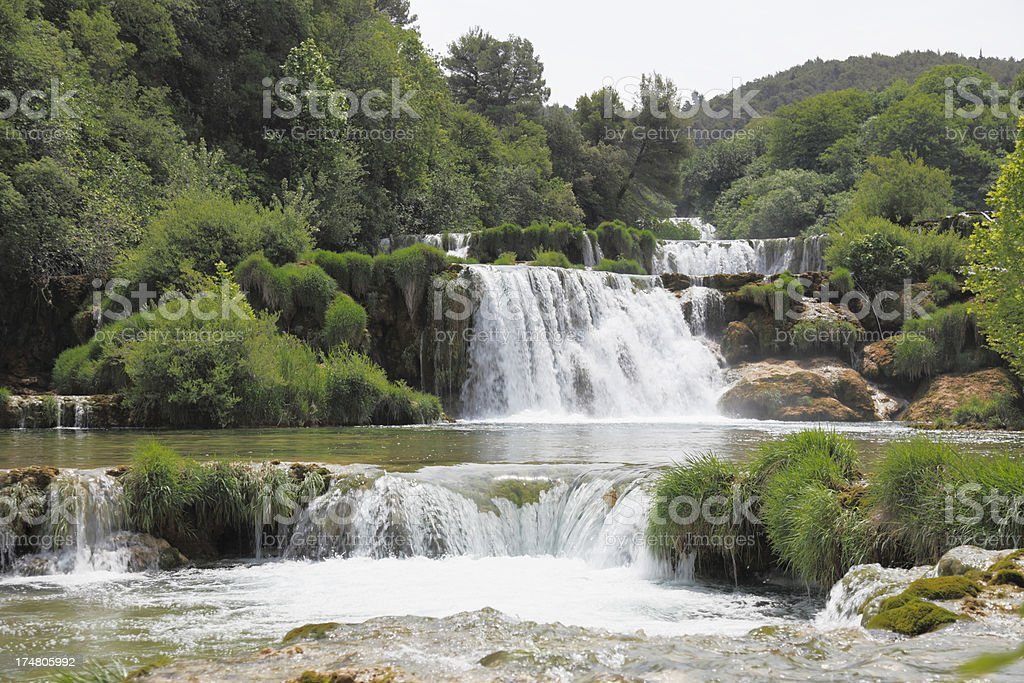 river cascade with streaming water rocks and green Croatia Krka royalty-free stock photo