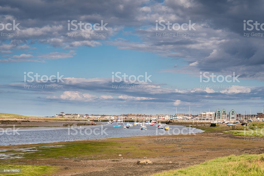 River Coquet flows passed Amble stock photo