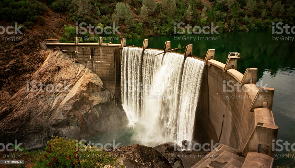 River dam with waterfalls and forests royalty-free stock photo