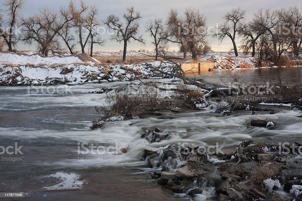 river diversion dam in winter scenery stock photo