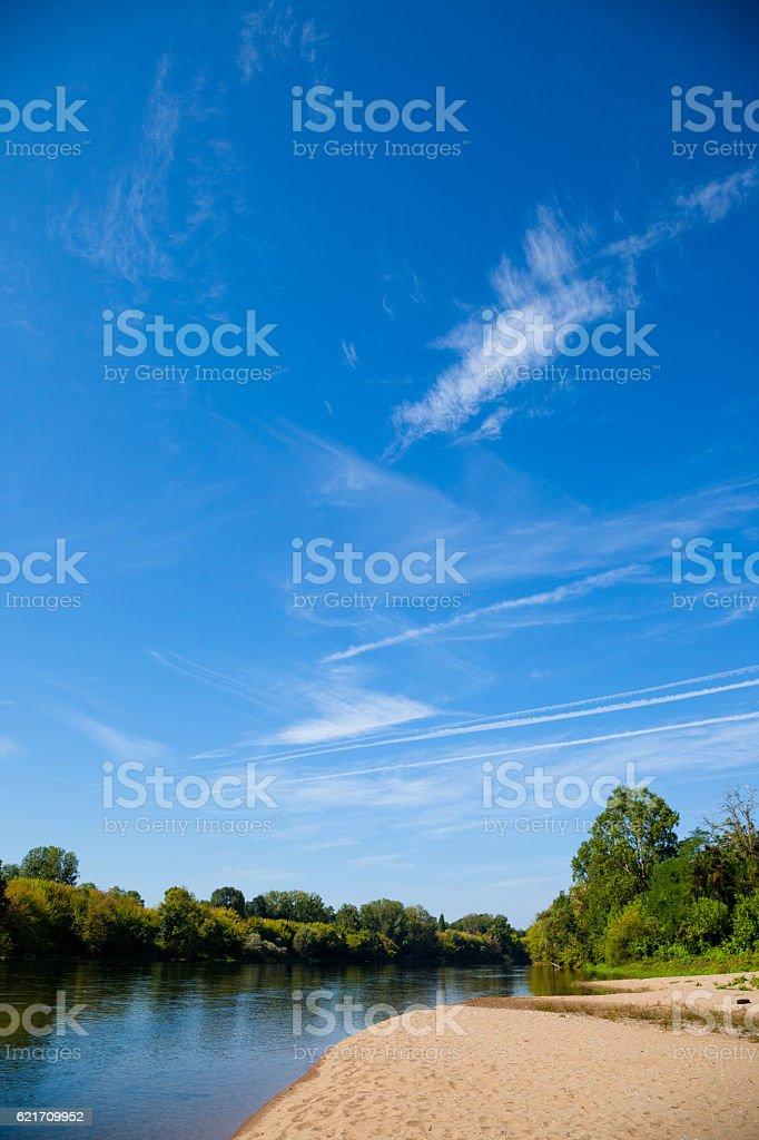 river Dordogne with sandbank in sunny France stock photo
