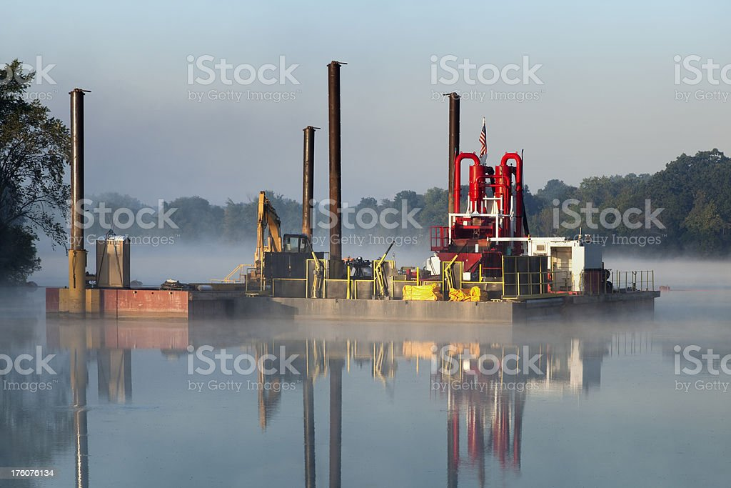 River Dredging Barge Reflecting in Water, Misty Fogy Dawn stock photo