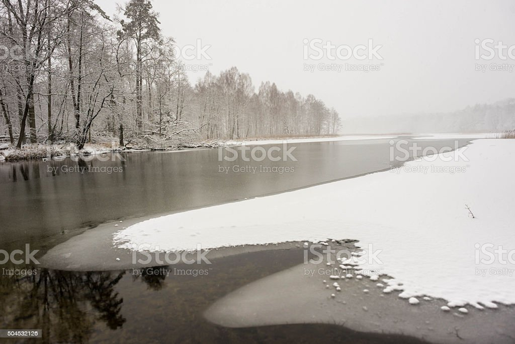 river during winter stock photo