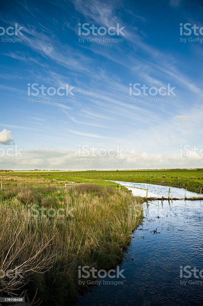 River farm pasture blue sky clouds royalty-free stock photo