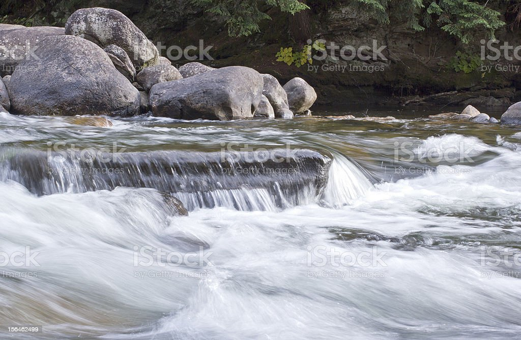 River Flowing Over Rocks royalty-free stock photo
