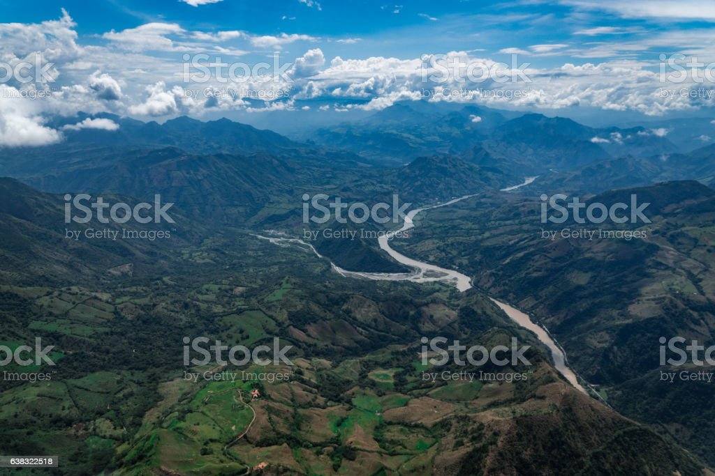 River flowing through green valleys stock photo