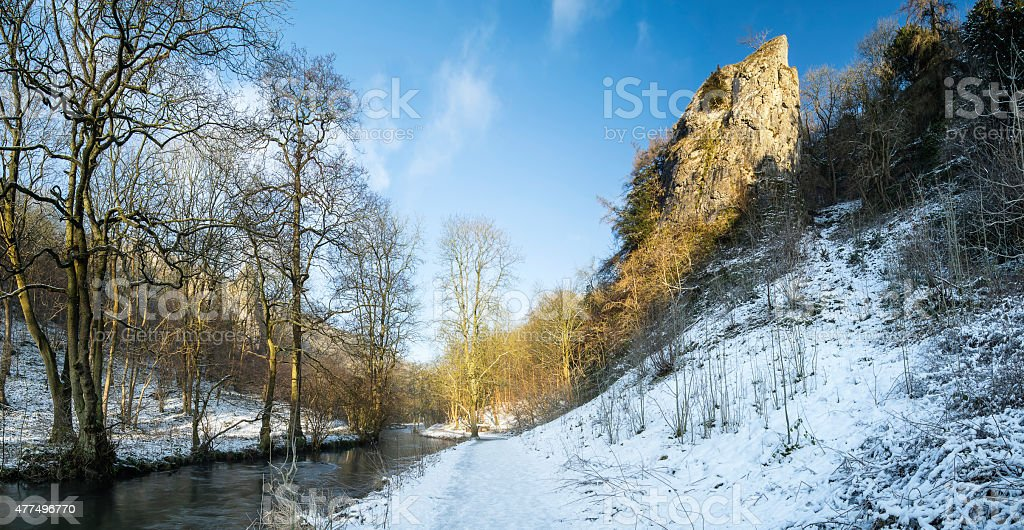 River flowing through snow covered Winter landscape in forest va stock photo