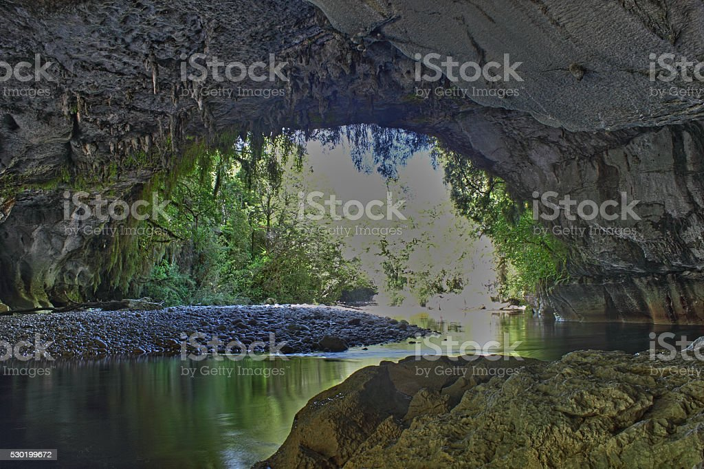River flowing underneath Oparara Arch, New Zealand stock photo