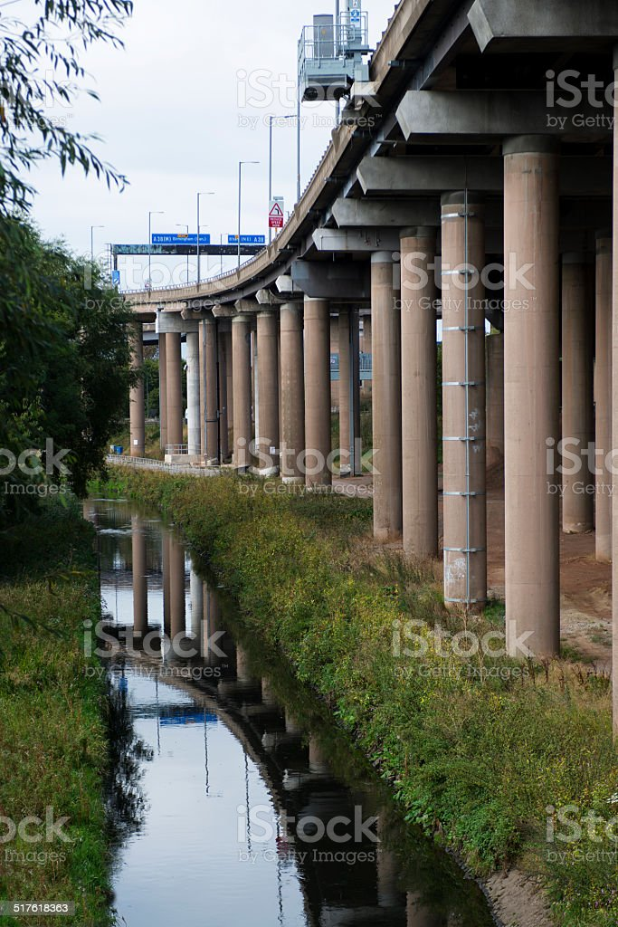 River flows by Motorway stock photo