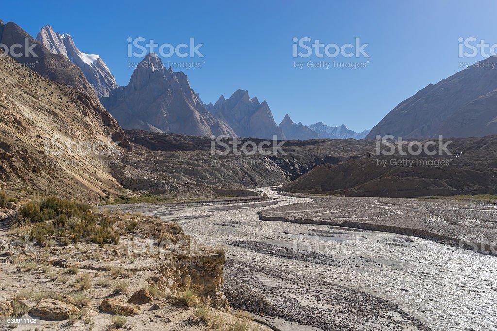 River from Baltoro glacier, Trango tower background, K2 trek, Pakistan stock photo