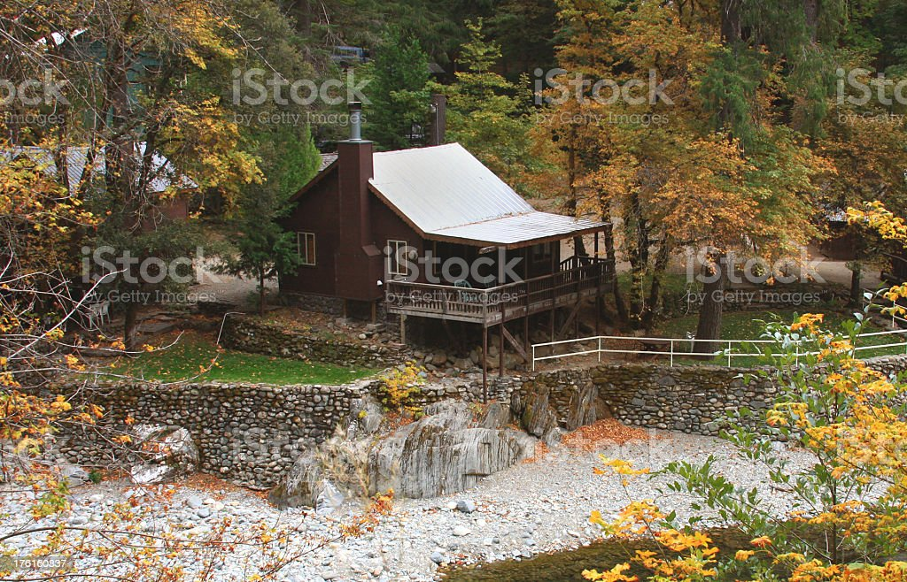 River front cabin with Fall colors in Northern California royalty-free stock photo