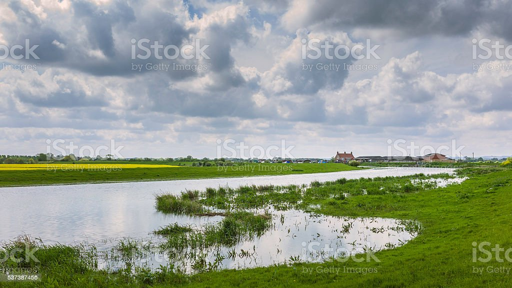 River Hull at high tide and surrounding fields in summer. stock photo