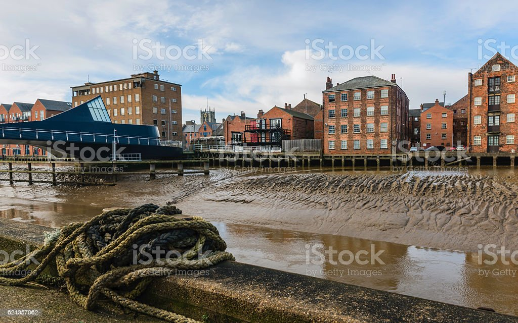 River Hull with bridge, flats, and church on the horizon. stock photo