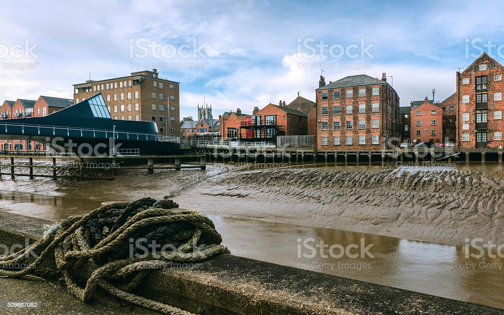River Hull with house, flats, church in Hull, Yorkshire, UK. stock photo