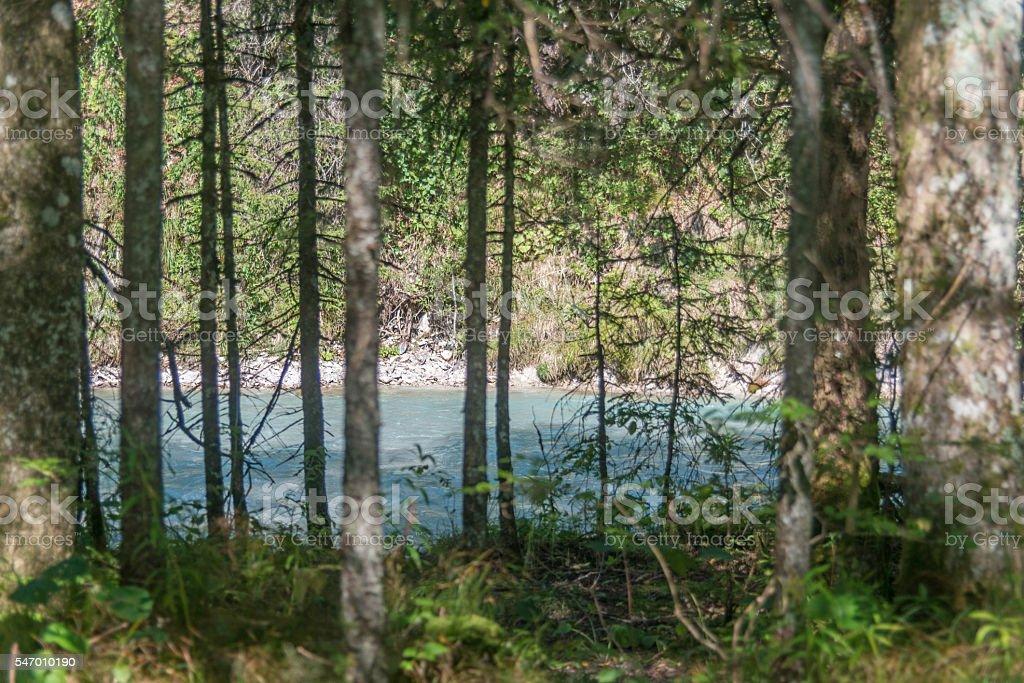 river in mountain panorama stock photo