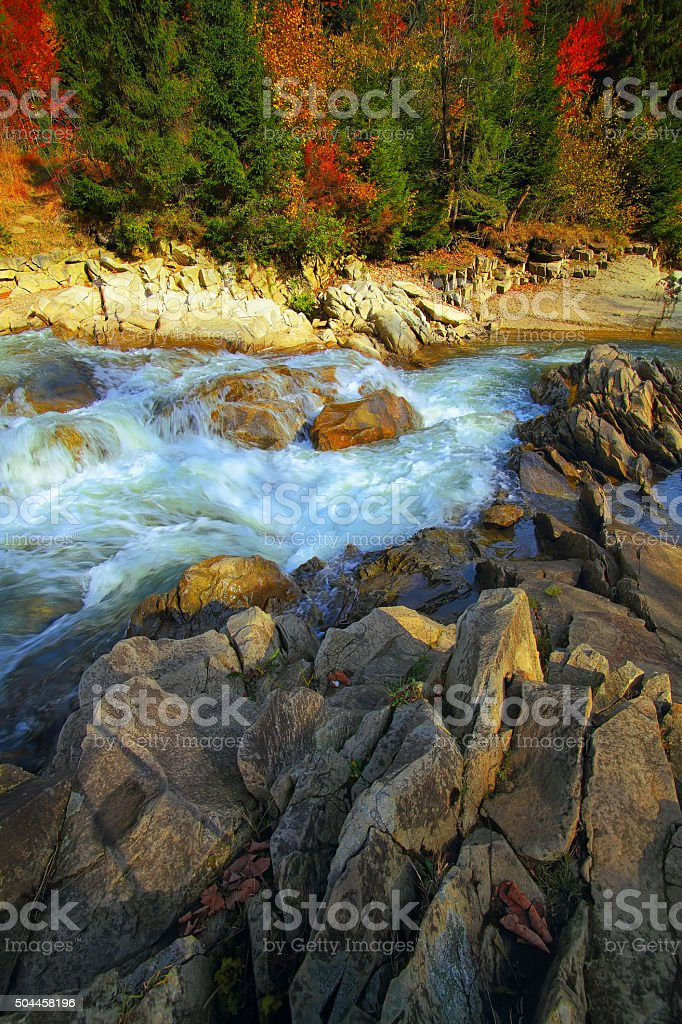 river in mountaines at autumn stock photo