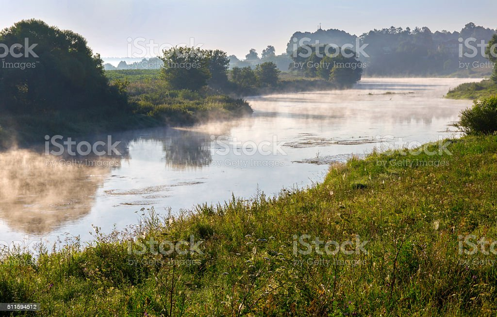 River is covered in morning mist. stock photo