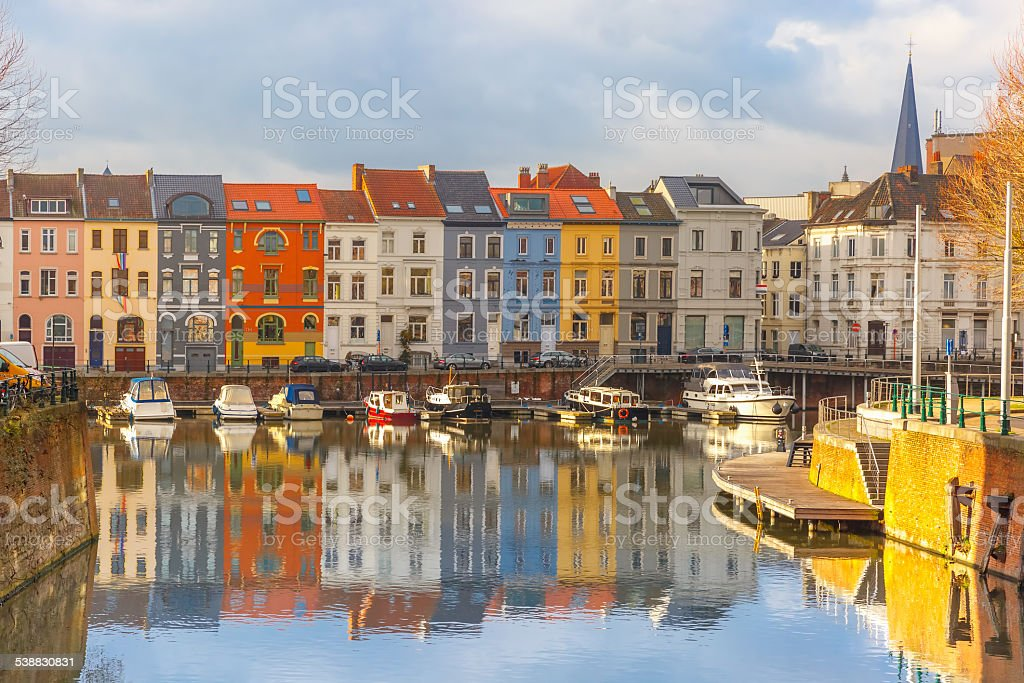 River Leie, colored houses and Belfry tower in Ghent, Belgium stock photo