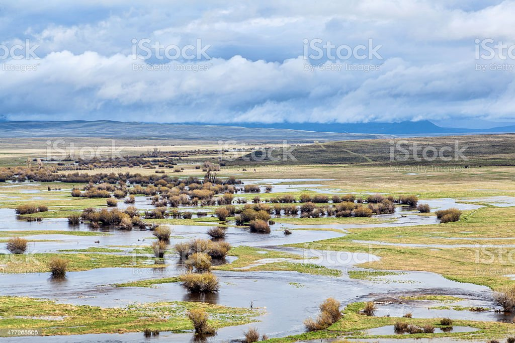 river meanders in a mountain valley stock photo