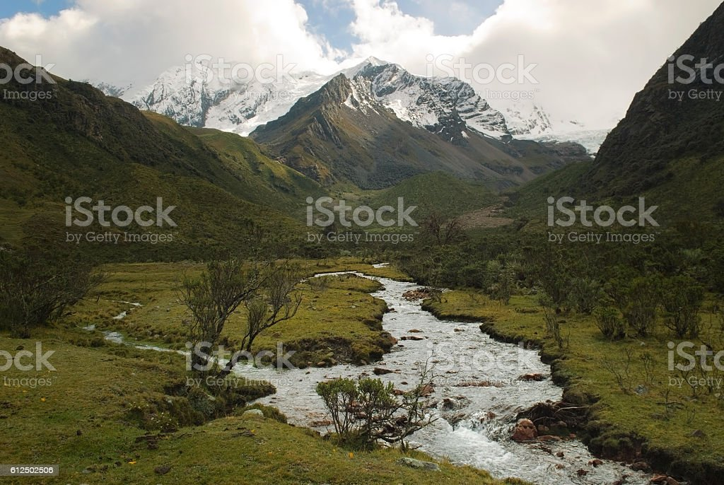 River of melted water of the Tullparahu glacier flowing down stock photo
